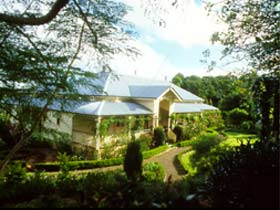 The Falls Rainforest Cottages - Accommodation Airlie Beach